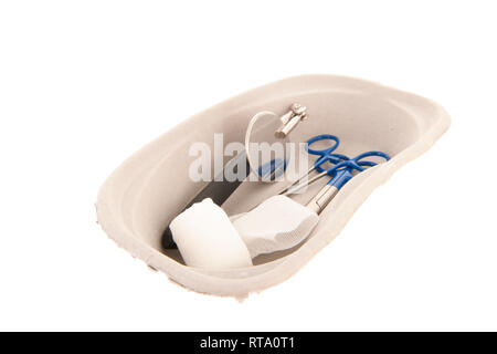 Medical first aid kit in renal pelvis carton box isolated over white background - Stock Photo