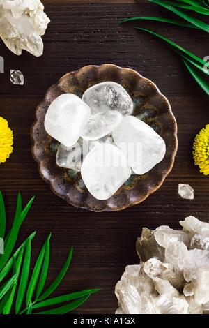 Quartz Crystals with Smoky Quartz and Mums on Dark Wood - Stock Photo