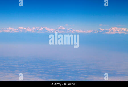 Himalaya mountains, in the clouds, view from the airplane - Stock Photo