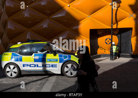 A Zero Emission BMW i3 Met Police patrol car drives past the temporary renovation hoarding of luxury brand Louis Vuitton in New Bond Street, on 25th February 2019, in London, England. - Stock Photo