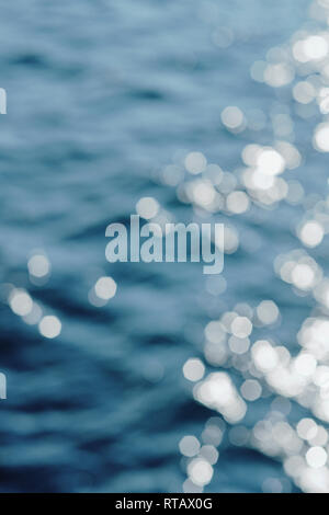 Sun Glistening on Sea - Water Background Full Frame with Thrown Focus and Highlights . - Stock Photo