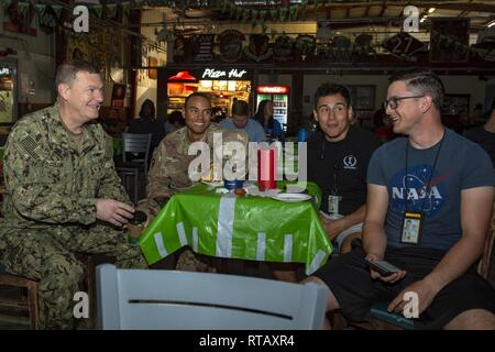 CAMP LEMONIER, Djibouti - Chief of Navy Reserve Vice Adm. Luke McCollum, visits forward-deployed service members during a Super Bowl party held at the base multipurpose facility, Feb. 4, 2019. Camp Lemonnier is an operational installation that enables U.S., allied and partner nation forces to be where and when they are needed to ensure security in Europe, Africa and Southwest Asia. - Stock Photo