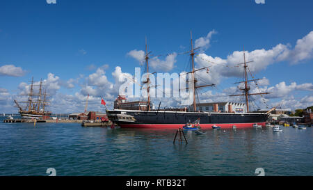 The mighty HMS Warrior ironclad warship in Portsmouth Harbour. A combination of steam-power and sailing propulsion - Stock Photo