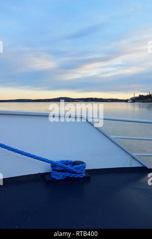 Detail of a ship lying moored in an ice covered harbor bay. - Stock Photo