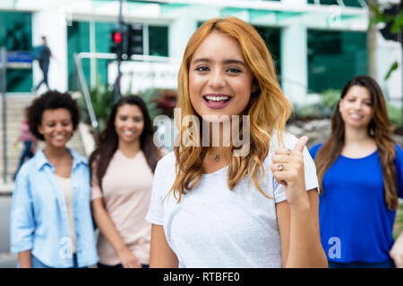 Caucasian woman with latin and hispanic and african girls outdoor in the city - Stock Photo