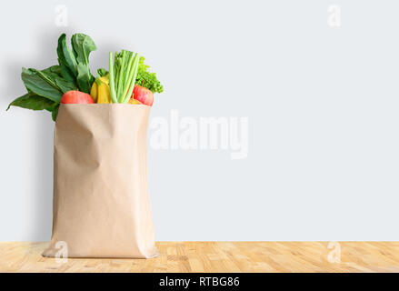Paper bag with healthy food over white background - Stock Photo