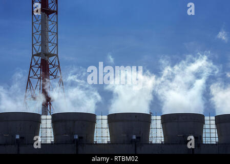 Smoke from chimneys at industrial estate showing BASF chemical production site in the port of Antwerp, Belgium - Stock Photo