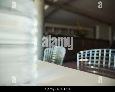 Abstract view of modern cafeteria with defocused view of modern metallic chairs  - Stock Photo