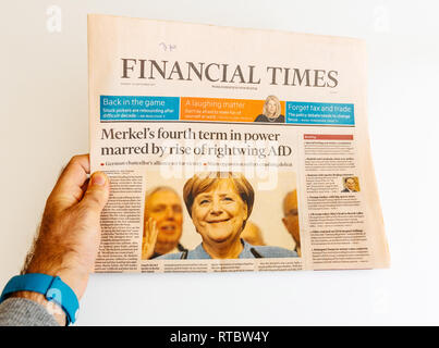 PARIS, FRANCE - SEP 25, 2017: Financial Times with portrait of Angela Merkel after election in Germany for the Chancellor of Germany, the head of the federal government - Stock Photo