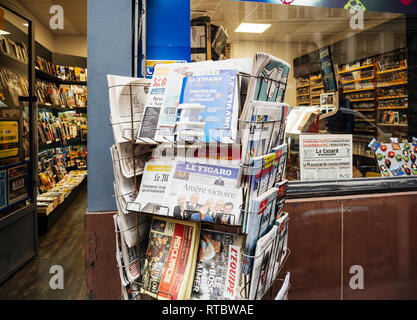 PARIS, FRANCE - SEP 25, 2017: International newspaper at press kiosk with portrait of Angela Merkel after election in Germany for the Chancellor of Germany, the head of the federal government - Stock Photo