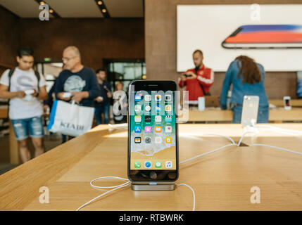 PARIS, FRANCE - SEP 22, 2017: New iPhone 8 and iPhone 8 Plus in Apple Store with home screen desktop apps and customers in the background  - Stock Photo