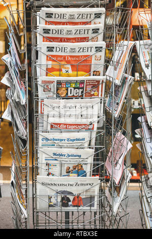 PARIS, FRANCE - SEP 25, 2017: International and German newspaper at press kiosk with portrait of Angela Merkel after election in Germany for the Chancellor of Germany, the head of the federal government - Stock Photo