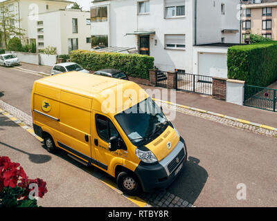 PARIS, FRANCE - JUN 23, 2017: La Poste yellow delivery van for the delivery on time package parcel - aerial view - Stock Photo