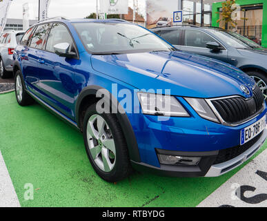 PARIS, FRANCE - NOV 7, 2017: Essai text translated as Test Drive cars with Skoda Superb and Octavia cars made by Volkswagen at the car dealership garage - Stock Photo