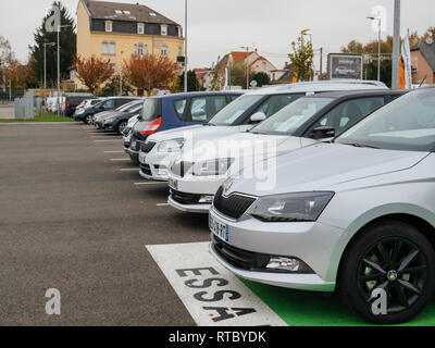 PARIS, FRANCE - NOV 7, 2017: Essai text translated as Test Drive cars with row of new Skoda Superb and Octavia cars made by Volkswagen at the car dealership garage - Stock Photo