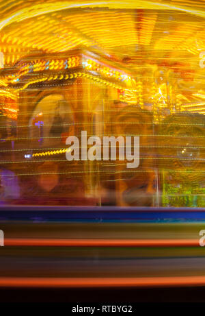 Blurred Roundabout at Lincoln Christmas market - Stock Photo