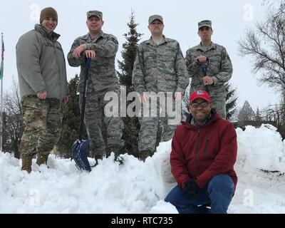 Members of the Washington Air National Guard's 242nd Combat Communications Squadron taking on additional duties in the snow in January 2019. Standing, left to right: Master Sgt. Caleb Frisbie (snowplow operator), Tech. Sgt. James Davis (snowplow operator, Red Card firefighter), Tech. Sgt. Nick Farver (snowplow operator), Staff Sgt. Scott Edge (snowplow operator, Red Card firefighter). Kneeling: Master Sgt. Tony Cannon (Adopt-A-Highway administrator). ( - Stock Photo