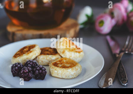 Cheesecakes from cottage cheese with blackberries for healthy breakfast. Close up. Diet concept. Low fat food. Sugar free. Copy space. Selective focus