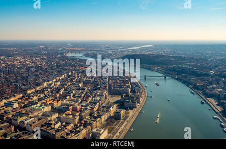 Image of areal view over the Hungarian capital city of Budapest with the river of danube and historical buildings and bridges during sunset