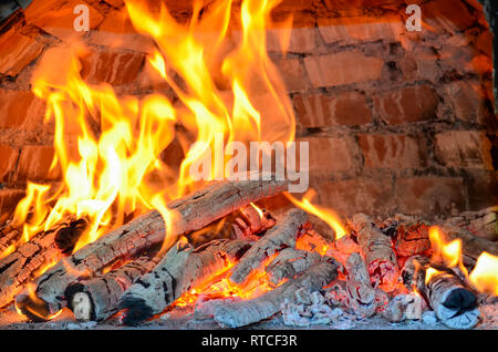 Pizza oven heating by burning beech and birch firewood providing high temperature and special smell, almoust done - Stock Photo