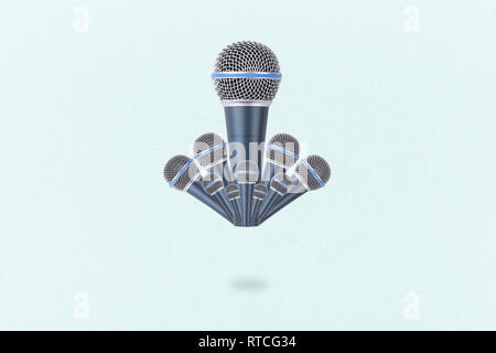 levitating microphones on a blue background, microphones in the air - Stock Photo