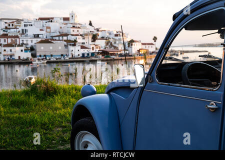 Old 2CV in front of an old city - Stock Photo