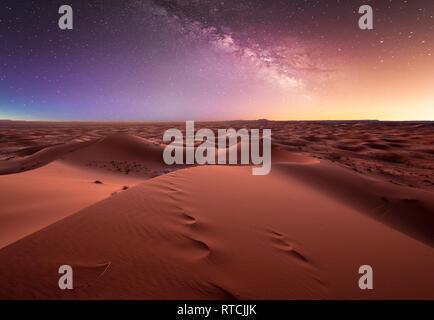 milky way over the dunes Erg Chebbi in the Sahara desert near Merzouga, Morocco , Africa. Beautiful sand landscape with stunning stars sky at night - Stock Photo