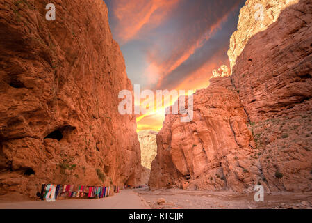 Todgha Gorge or Gorges du Toudra is a canyon in High Atlas Mountains near the town of Tinerhir, Morocco . A series of limestone river canyons sunset