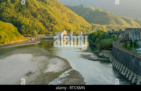 Late afternoon landscape near Maddalena Bridge in Lucca, Tuscany, Italy. - Stock Photo