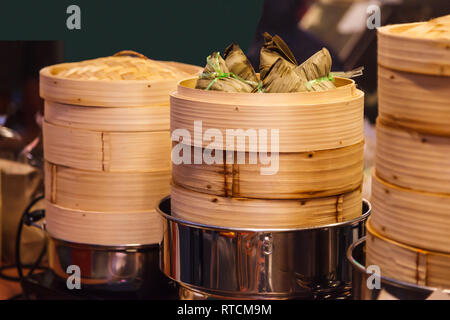 Tasty Thai Street Food Cuisine, Zongzi (sticky rice dumplings, Ba-chang), traditional Chinese rice dish made of steamed glutinous rice stuffed with di - Stock Photo