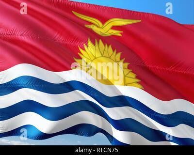 Flag of Kiribati waving in the wind against deep blue sky. High quality fabric. - Stock Photo