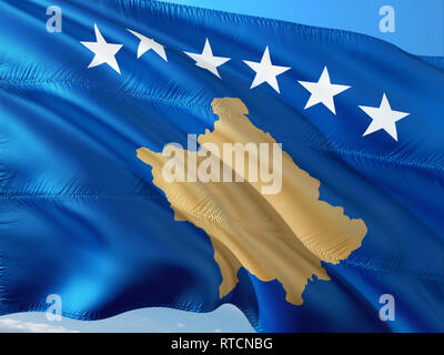 Flag of Kosovo waving in the wind against deep blue sky. High quality fabric. - Stock Photo