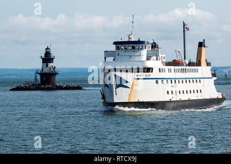 Orient Point, New York, USA – 27 July 2017: The Mary Ellen ferry ship is passing the Orient Point Lighthouse while transporting people and cars from N - Stock Photo