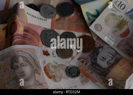 British money on euros. Notes and coins - Stock Photo