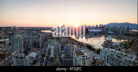 Aerial Panoramic view of a modern city during a sunny summer sunset. Taken in Downtown Vancouver, British Columbia, Canada. - Stock Photo