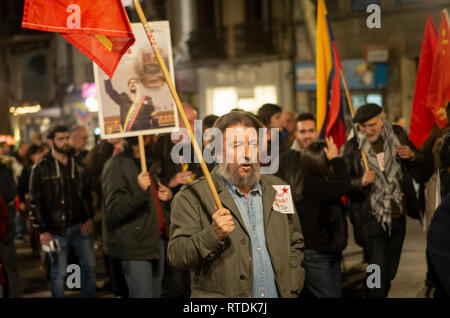 Protesters are seen holding flags during the protest. Hundreds of people protest against the intervention of United States in Venezuela marching from Atocha to Puerta del Sol in Madrid. - Stock Photo