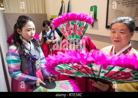 London, UK. 1st March 2019. Korean Ladies prepare to perform the traditional Buchaechum also known as the Fan Dance on the day Korea Commemorates 100th Anniversary of March 1st Independence Movement at New Malden Methodist Church, London, England, UK The historic remembrances have implications for modern-day relations between the two Koreas, and with Japan. On Friday North and South Koreans in New Malden commemorate the 100th anniversary of the March 1st Movement, a mass demonstration of Korean resistance against Japanese colonial rule. Credit: Jeff Gilbert/Alamy Live News - Stock Photo