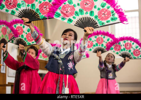 London, UK. 1st March 2019. North and South Korean Ladies perform the Buchaechum also called a Fan Dance on the day Korea Commemorates 100th Anniversary of March 1st Independence Movement at New Malden Methodist Church, London, England, UK The historic remembrances have implications for modern-day relations between the two Koreas, and with Japan. On Friday North and South Koreans in New Malden commemorate the 100th anniversary of the March 1st Movement, a mass demonstration of Korean resistance against Japanese colonial rule. Credit: Jeff Gilbert/Alamy Live News - Stock Photo
