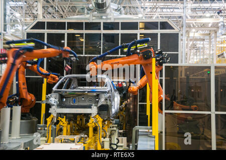 Guangzhou, China. 1st March, 2019. Robots working and measuring on the production line at the Guangzhou factory. Official launch of the GAC NE Aion S electric car billed as the Chinese Tesla Model 3 killer at the GAC NE factory in Guangzhou, Guangdong Province, China. Mark Andrews/Alamy Live News - Stock Photo
