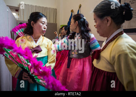 London, UK. 1st March 2019. North and South Korean Ladies perform the Buchaechum also called a Fan Dance on the day Korea Commemorates 100th Anniversary of March 1st Independence Movement at New Malden Methodist Church, London, England, UK Credit: Jeff Gilbert/Alamy Live News - Stock Photo
