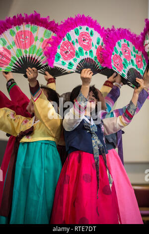 London, UK. 1st March 2019. North and South Korean Ladies perform the Buchaechum also called a Fan Dance on the day Korea Commemorates 100th Anniversary of March 1st Independence Movement. New Malden Methodist Church, London, England, UK Credit: Jeff Gilbert/Alamy Live News - Stock Photo