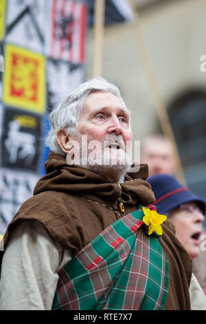 Cardiff, Wales, UK. March 1st 2019. 'St David' sings the Welsh national anthem at the end of the St David's Day Parade in Cardiff city centre. Credit: Mark Hawkins/Alamy Live News - Stock Photo