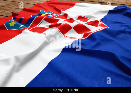 Flag of Croatia on a wooden desk background. Silk Croatian flag top view. - Stock Photo