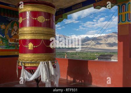Big prayer wheel in Thiksey Gompa monastery in Ladakh, India. - Stock Photo