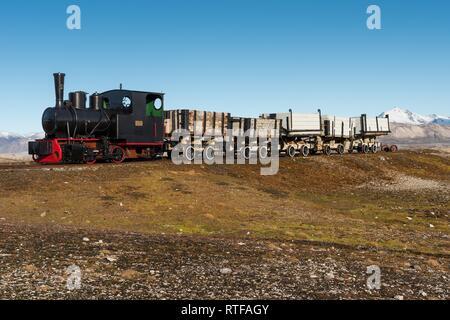 Historic mine train in front of the Kongsfjorden, Ny-Alesund, Spitsbergen, Svalbard Islands, Svalbard and Jan Mayen, Norway - Stock Photo