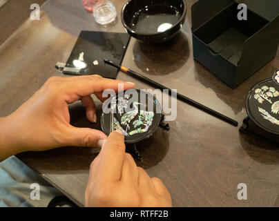 Najeon or mother-of-pearl decoupage on replica of soban or individual table available for crafting at the Korean Traditional Culture Experience Center - Stock Photo