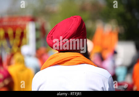 indian man with red turban and white shirt - Stock Photo