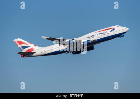 British Airways Boeing 747 Jumbo jet airliner plane G-CIVR taking off from London Heathrow Airport, UK, in blue sky. Flight departure. Space for copy - Stock Photo