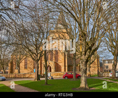 DORNOCH SUTHERLAND SCOTLAND THE CATHEDRAL SURROUNDED BY TREES IN WINTER - Stock Photo