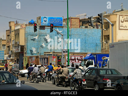 Tehran, Iran - June 12, 2018: Busy traffic with many motorbikes in Tehran, Iran. Tehran is rated as one of the world's most polluted cities. - Stock Photo